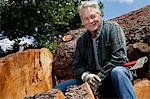 Smiling senior man sitting on logs Stock Photo - Premium Royalty-Free, Artist: Michael Mahovlich, Code: 693-05794390