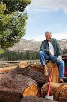 forestry - Man sitting on chopped tree trunk Stock Photo - Premium Royalty-Freenull, Code: 693-05794392