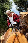 Senior man cutting tree stump with chainsaw Stock Photo - Premium Royalty-Free, Artist: ableimages, Code: 693-05794405