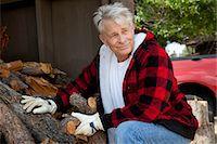 forestry - Senior man sitting besides firewood log Stock Photo - Premium Royalty-Freenull, Code: 693-05794407