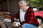 Senior man sitting besides firewood log Stock Photo - Premium Royalty-Free, Artist: Michael Mahovlich, Code: 693-05794407