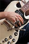 Close-up of man's hand playing electric guitar Stock Photo - Premium Royalty-Free, Artist: Bettina Salomon, Code: 693-05794449