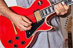 Midsection of man playing electric guitar Stock Photo - Premium Royalty-Freenull, Code: 693-05794456