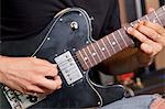 Close-up view of man playing electric guitar Stock Photo - Premium Royalty-Freenull, Code: 693-05794459