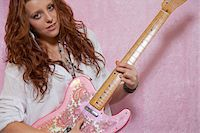 Pretty teenage girl playing guitar Stock Photo - Premium Royalty-Freenull, Code: 693-05794465