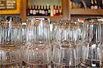 Upturned glasses at a pub counter Stock Photo - Premium Royalty-Free, Artist: Michael Mahovlich, Code: 693-05794554