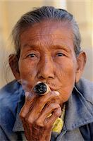 Old woman smokes a marihuana cigar, Bagan, Myanmar, Asia Stock Photo - Premium Rights-Managednull, Code: 841-05794778