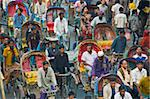 Busy rickshaw traffic on a street crossing in Dhaka, Bangladesh, Asia Stock Photo - Premium Rights-Managed, Artist: Robert Harding Images, Code: 841-05794824