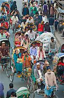 dhaka - Busy rickshaw traffic on a street crossing in Dhaka, Bangladesh, Asia Stock Photo - Premium Rights-Managednull, Code: 841-05794826