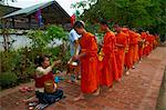 Procession of Buddhist monks collecting alms and rice at dawn, Luang Prabang, Laos, Indochina, Southeast Asia, Asia Stock Photo - Premium Rights-Managed, Artist: Robert Harding Images, Code: 841-05796422