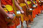 Procession of Buddhist monks collecting alms and rice at dawn, Luang Prabang, Laos, Indochina, Southeast Asia, Asia Stock Photo - Premium Rights-Managed, Artist: Robert Harding Images, Code: 841-05796423