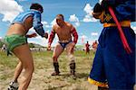 Wrestling at the national Naadam festival, Ovorkhangai, Mongolia, Central Asia, Asia Stock Photo - Premium Rights-Managed, Artist: Robert Harding Images, Code: 841-05796524