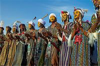 Group of Wodaabe (Bororo) men with faces painted for the annual Gerewol male beauty contest, the general reunion of West Africa for the Wodaabe Peul (Bororo Peul) people, Niger, West Africa, Africa Stock Photo - Premium Rights-Managednull, Code: 841-05796685