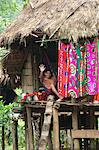 Embera Indian man waves from his hammock in his thatched hut on stilts, Embera Drua Village, Chagres River, Soberania National Park, Panama, Central America Stock Photo - Premium Rights-Managed, Artist: Robert Harding Images, Code: 841-05797102