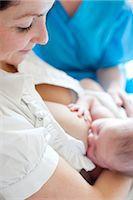 Newborn baby breastfeeding Stock Photo - Premium Royalty-Freenull, Code: 679-05797326