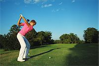 Golfer Preparing for Tee Shot Stock Photo - Premium Rights-Managednull, Code: 858-05799331