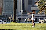 Young Woman Stretching Arm in City Park Stock Photo - Premium Rights-Managed, Artist: Aflo Sport, Code: 858-05799350