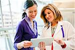 A doctor and patient working on a tablet together. Stock Photo - Premium Royalty-Freenull, Code: 618-05799679