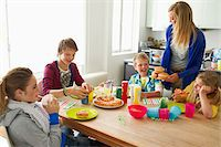 Family at dining table eating together Stock Photo - Premium Royalty-Freenull, Code: 618-05800230