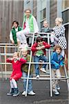 Portrait of schoolchildren on jungle gym at school Stock Photo - Premium Royalty-Freenull, Code: 618-05800333