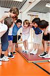 Young schoolboys in gym having a huddle Stock Photo - Premium Royalty-Freenull, Code: 618-05800350