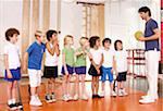 Young schoolchildren and gym teacher at school Stock Photo - Premium Royalty-Freenull, Code: 618-05800356