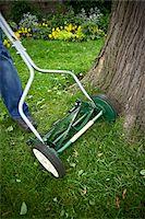 Man Cutting Grass with Push Mower, Toronto, Ontario, Canada Stock Photo - Premium Royalty-Freenull, Code: 600-05800640