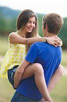 preteen girl boyfriends - Teenage couple hugging outdoors Stock Photo - Premium Royalty-Freenull, Code: 649-05800846