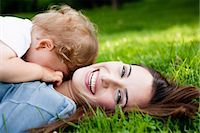 shy baby - Mother holding toddler in park Stock Photo - Premium Royalty-Freenull, Code: 649-05800965