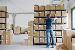 Man filing cardboard boxes in storage Stock Photo - Premium Royalty-Free, Artist: Aflo Relax, Code: 649-05801079