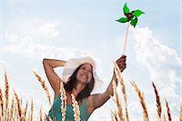 Woman holding pinwheel in wheatfield Stock Photo - Premium Royalty-Freenull, Code: 649-05801218