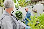 Older couple gardening in backyard Stock Photo - Premium Royalty-Free, Artist: Photocuisine, Code: 649-05801270