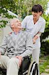Nurse wheeling older patient outdoors Stock Photo - Premium Royalty-Freenull, Code: 649-05801277