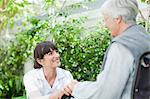 Nurse talking to older patient outdoors Stock Photo - Premium Royalty-Free, Artist: Cultura RM, Code: 649-05801279