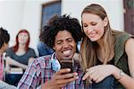 Students using cell phone on campus Stock Photo - Premium Royalty-Freenull, Code: 649-05801339