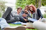 Students using cell phone on grass Stock Photo - Premium Royalty-Freenull, Code: 649-05801380