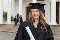 Graduate with her degree on campus Stock Photo - Premium Royalty-Freenull, Code: 649-05801409