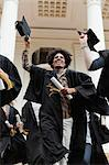 Graduates cheering on campus Stock Photo - Premium Royalty-Free, Artist: Blend Images, Code: 649-05801415