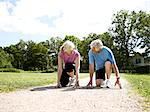 Older couple crouched in start position