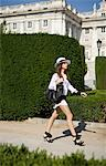 Woman walking by Palacio Real Stock Photo - Premium Royalty-Free, Artist: RelaXimages, Code: 649-05801933