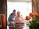Nurse and older woman with jigsaw puzzle Stock Photo - Premium Royalty-Free, Artist: Cultura RM, Code: 649-05801959
