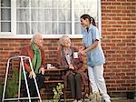 Nurse bringing older couple coffee Stock Photo - Premium Royalty-Free, Artist: Robert Harding Images, Code: 649-05801975