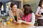 Smiling women talking in cafe Stock Photo - Premium Royalty-Free, Artist: Cultura RM, Code: 649-05802129