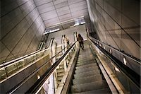 People on escalator in underground station Stock Photo - Premium Royalty-Freenull, Code: 6102-05802543