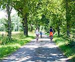 Mother with daughters cycling on rural road Stock Photo - Premium Royalty-Free, Artist: Oriental Touch, Code: 6102-05802613