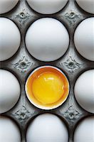 food - Eggs in Carton with One Broken Shell Stock Photo - Premium Royalty-Freenull, Code: 600-05803156