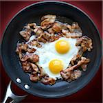 Bacon and Eggs in Frying Pan Stock Photo - Premium Royalty-Free, Artist: Andrew Kolb, Code: 600-05803158