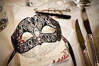 Mask at Place Setting Stock Photo - Premium Rights-Managednull, Code: 700-05803127