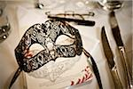Mask at Place Setting Stock Photo - Premium Rights-Managed, Artist: Ikonica, Code: 700-05803127