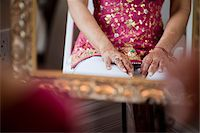 Bride's Hands Decorated with Mendhi Stock Photo - Premium Rights-Managednull, Code: 700-05803132